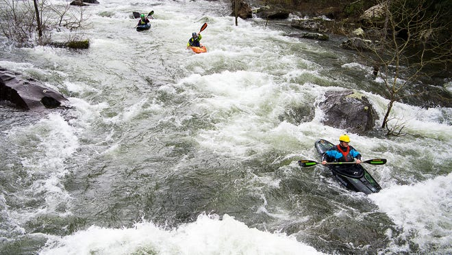 Kayakers navigates on a series of large rapids March 25, 2017 on the Cheoah River during the river's release. Whitewater sports contribute to the billion-dollar outdoor recreation industry in North Carolina.