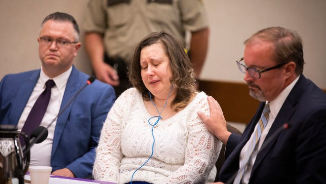 Nataliia Karia, center, with her lawyers Brock Hunter, right, and Ryan Else, reacts during her sentencing hearing in Hennepin County District Court in Minneapolis, Monday, July 16. Karia, a Minneapolis day care owner, was sentenced to 10 years of probation for trying to kill a toddler in her home by hanging him from a noose.