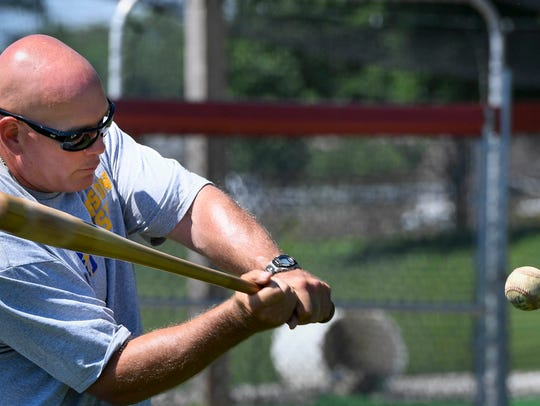 Henderson Flash manager J.D. Arndt hits balls for the outfielders as the Henderson Flash baseball summer collegiate baseball team gets ready for their debut in Huntingburg Thursday, May 30, 2017.