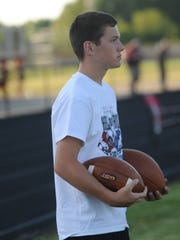 Hagerstown eighth-grader Noah Snodgrass, son of head varsity football coach Scott Snodgrass, was the ball boy during the Indiana Football Hall of Fame East West All-Star Classic at Anderson High School Friday, June 17, 2016.