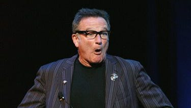"FILE - This Nov. 7, 2007 file photo shows comedian Robin Williams performing at the NY Comedy Festival Event ""Stand Up for Heroes: A Benefit for the Bob Woodruff Family Fund,"" in New York."