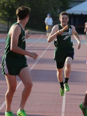 Pleasantville's Eric Hughes hands the baton to Dylan Bronkema as they compete in the Men's East Coast DMR on day 1 of the Loucks Games at White Plains High School May 12, 2016.
