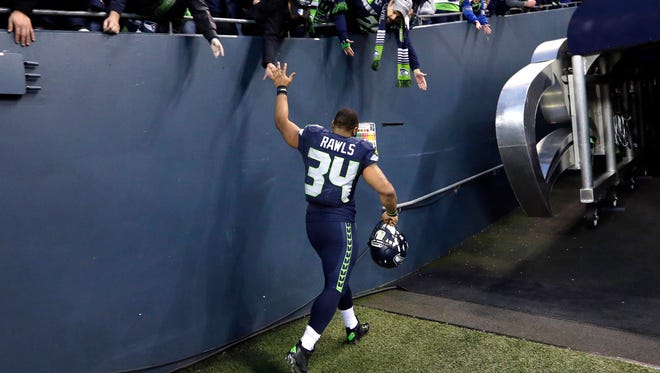 Seattle Seahawks running back Thomas Rawls greets fans after an NFL football game against the San Francisco 49ers, Sunday, Nov. 22, 2015, in Seattle. The Seahawks won 29-13. (AP Photo/Elaine Thompson)