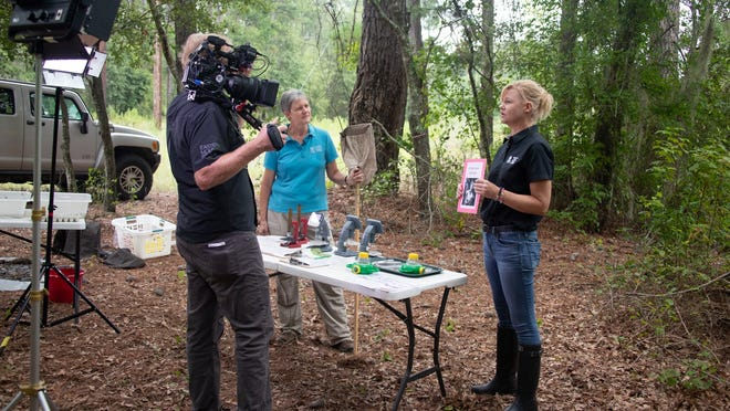 """Savannah River Nuclear Solutions (SRNS) is creating a series of videos and learning resources to bring Savannah River Site (SRS) ecology to classrooms in place of traditional field trips to SRS. Beth Eberhard, left, and Kimberly Fickling, both with the University of South Carolina Aiken Ruth Patrick Science Education Center, are shown working on the lesson """"Wet Wonders."""" SRNS employee Brad Bohr is recording the presentation."""