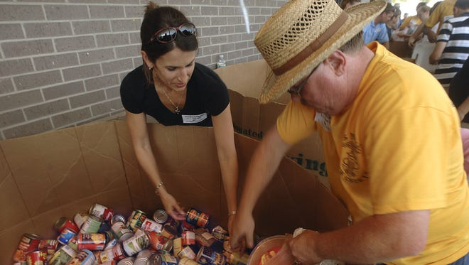 Volunteers sort food during the 2009 Stamp Out Hunger Food Drive. (News Journal file photo)