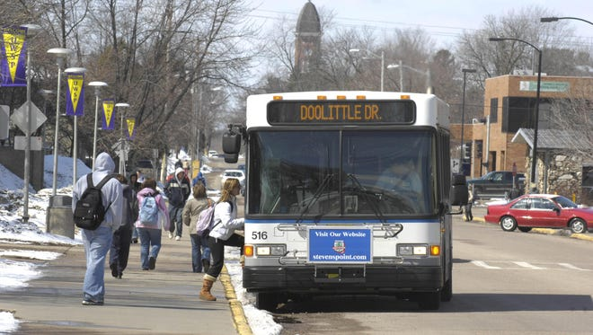 A student boards the city bus at a stop on the University of Wisconsin-Stevens Point campus in this file photo. The city and county may combine their transportation resources to provide better service to users.