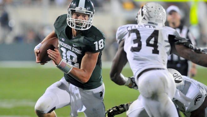 Quarterback Connor Cook and Michigan State University begin the 2015 season Friday at Western Michigan University.