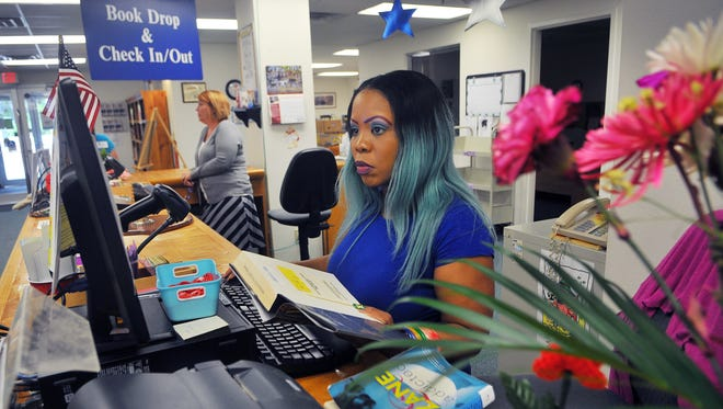 Alake Davis of Titusville, a circulation supervisor, works the front desk of the Mims/Scottsmoor Public Library. There are plenty of fun family activities offered through Brevard's libraries. (Just don't do on Labor Day, because no one will be there.)
