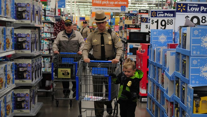 Children shop with officers at Wal-Mart Supercenter in Berlin.
