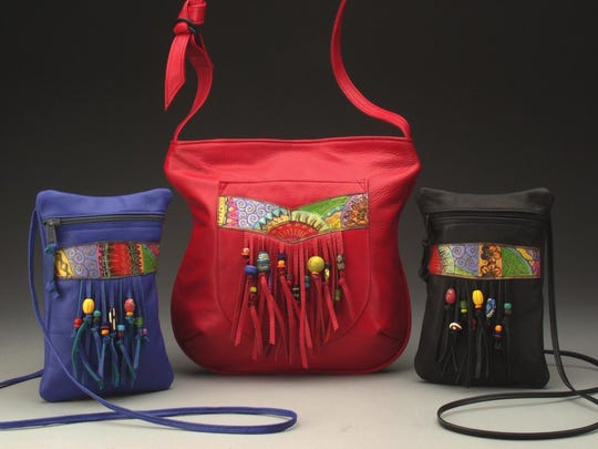 Leather bags by Ilze Heider, who is taking part in the second Door County Wearable Art Show of the season.