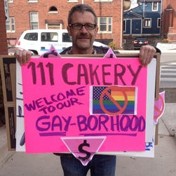 Todd Fuqua of Indianapolis protests 111 Cakery on March 14, 2014, after the bakery refused to make a cake for a same-sex commitment ceremony.