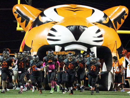 The El Paso High Tigers rush onto their home field to play the Andress Eagles Friday night.