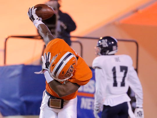 UTEP wide receiver Jaquan White takes a bow in the endzone as fireworks light the sky over the Sun Bowl during the Miners' 24-21 win over Rice Friday night.