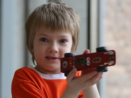 "PINEWOOD DERBY: Scott Honisch, 6, holds his ""Kylo Red"" winning car after taking first place in the North Wilmington Cub Scout Pack 67's Pinewood Derby Saturday."