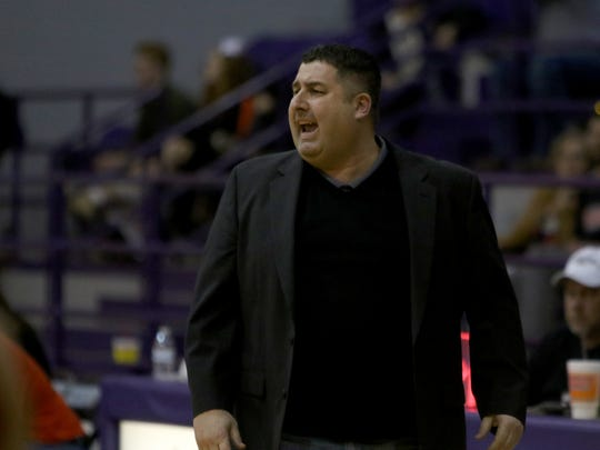 Glen Rose head girls basketball coach Ramsey Ghazal calls out to his players in the Region I-4A Area playoff against Burkburnett Thursday, Feb. 16, 2017, in Jacksboro. Glen Rose defeated Burkburnett 63-54.