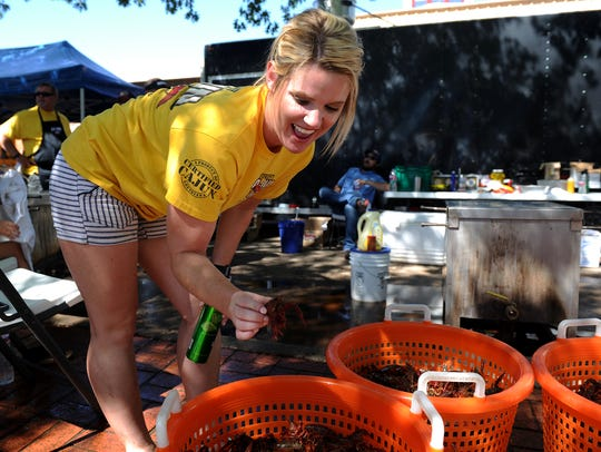 Brea Gamble gets a closer look at the crawfish before