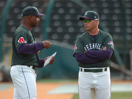 Billy McMillon, left, spent four seasons as a coach and manager with the Greenville Drive; this year, he has visited Fluor Field as roving minor league outfield and base running coordinator for the Boston Red Sox.