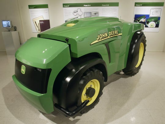 Side view of the John Deere driverless tractor on exhibit at the Iowa State College of Design. The tractor was adapted from a 75-horsepower Deere tractor designed in Waterloo, built in Georgia and sold commercially.