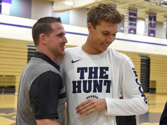 Spanish Springs' Jalen Townsell, who signed to playing basketball at Nevada, gets congratulated by Spanish Springs basketball coach Kyle Penney after a signing ceremony in the Spanish Springs gym on Wednesday.