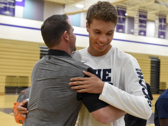 Spanish Springs' Jalen Townsell, who will play basketball at Nevada, gets a hug from the Spanish Springs coach Kyle Penney after a signing ceremony in the Spanish Springs gym on Wednesday.