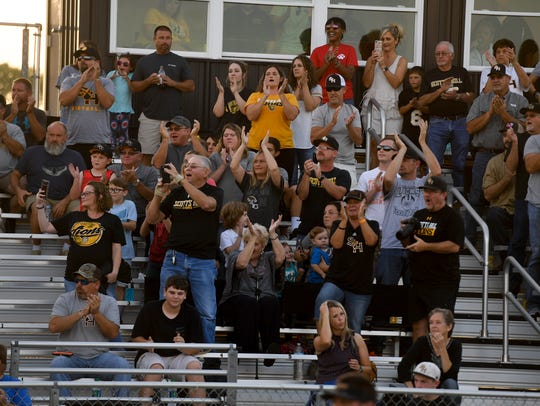 Scotts Hill High School fans cheer on their team as