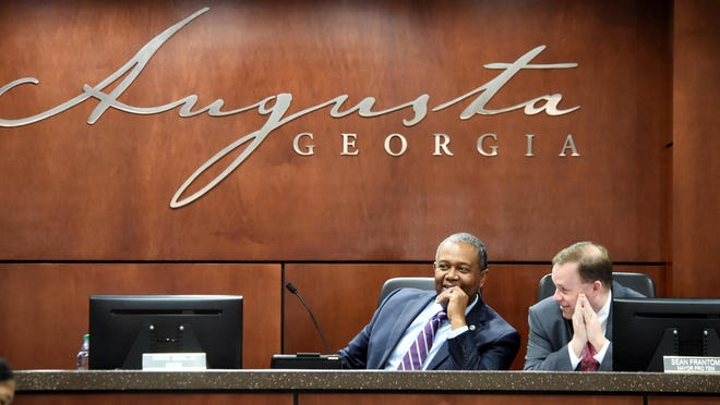 Augusta Mayor Hardie Davis (left) and Mayor Pro Tem Sean Frantom chat during a commission meeting before the meetings went online-only due to COVID-19. The two discussed the makeup of a panel reviewing applications for small-business loans at a Tuesday streamed meeting.