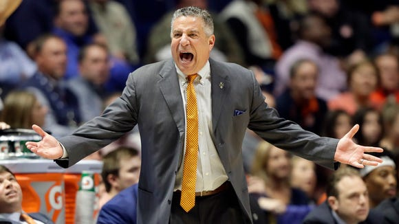 Auburn coach Bruce Pearl yells at an official during the first half of the team's NCAA college basketball game against Missouri at the Southeastern Conference tournament Wednesday, March 8, 2017, in Nashville, Tenn.