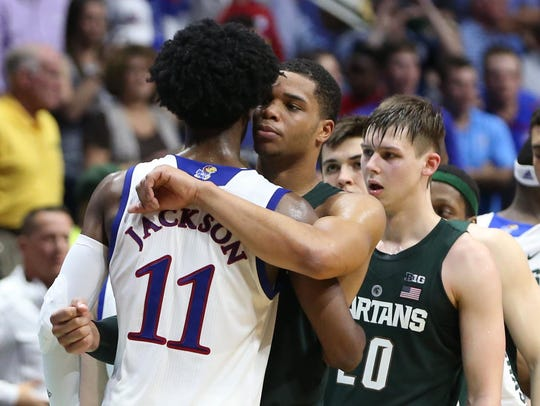 Kansas guard Josh Jackson (11) greets Michigan State's