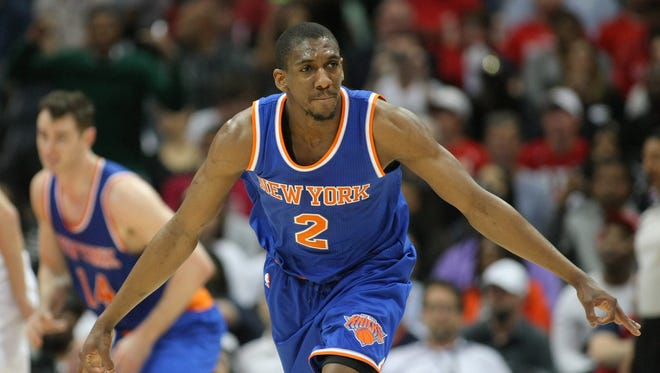 New York Knicks guard Langston Galloway (2) celebrates after a three-point basket against the Atlanta Hawks in the fourth quarter at Philips Arena.