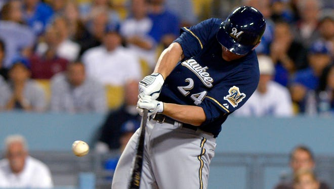 Brewers pinch-hitter Lyle Overbay drives in three runs with an eighth-inning double.