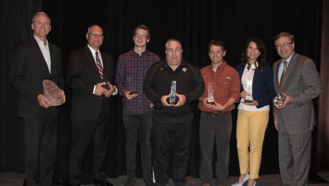 Visitor Industry awardees at the Sioux Falls Convention and Visitors Bureau annual luncheon held May 8, from left: Gov. Dennis Daugaard, City Councilor Rex Rolfing, Wes Eisenhauer, Frank Gurnick, Mike Stephenson, Julie Coleman, Mayor Mike Huether.