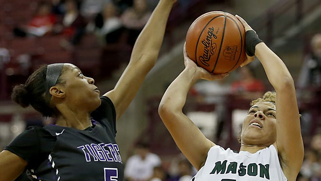 Mason forward Tihanna Fulton scores against Pickerington Central center Kyla Whitehead during their Division I semifinal at Jerome Schottenstein Center in Columbus Friday, March 16, 2018.