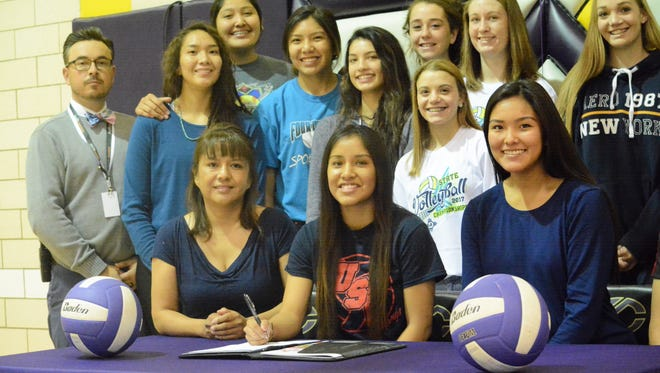 Kirtland Central libero Shania John inked with University of the Southwest's volleyball program on Monday.