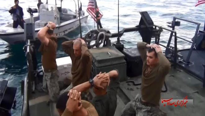 This frame grab from January 12, 2016 video by the Iranian state-run IRIB News Agency, shows detention of American Navy sailors by the Iranian Revolutionary Guards in the Persian Gulf, Iran. The 10 U.S. Navy sailors detained by Iran after their two small boats allegedly drifted into Iranian territorial waters around one of Iran's Persian Gulf islands a day earlier have were freed, the following day.