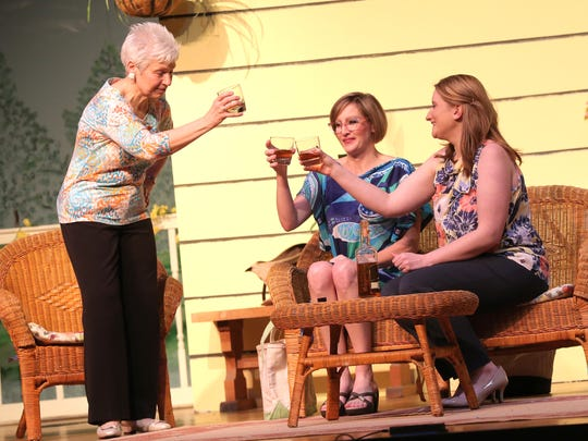 """From left, Nancy Green, Erin Shawk and Kritina Frye rehearse a scene at the Galion Community Theatre from """"The Savannah Sipping society"""" in 2018."""