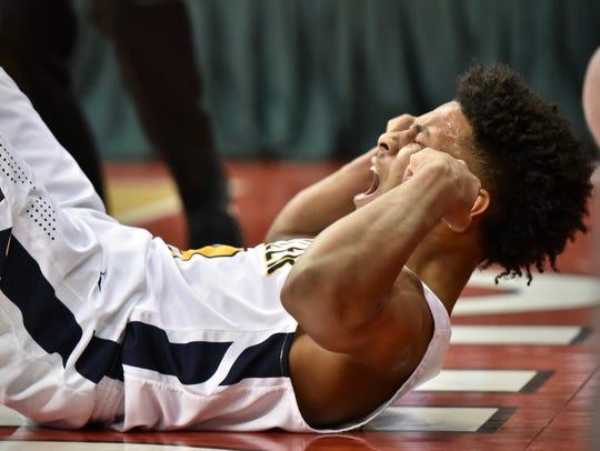 Moeller's Miles McBride celebrates after making a basket