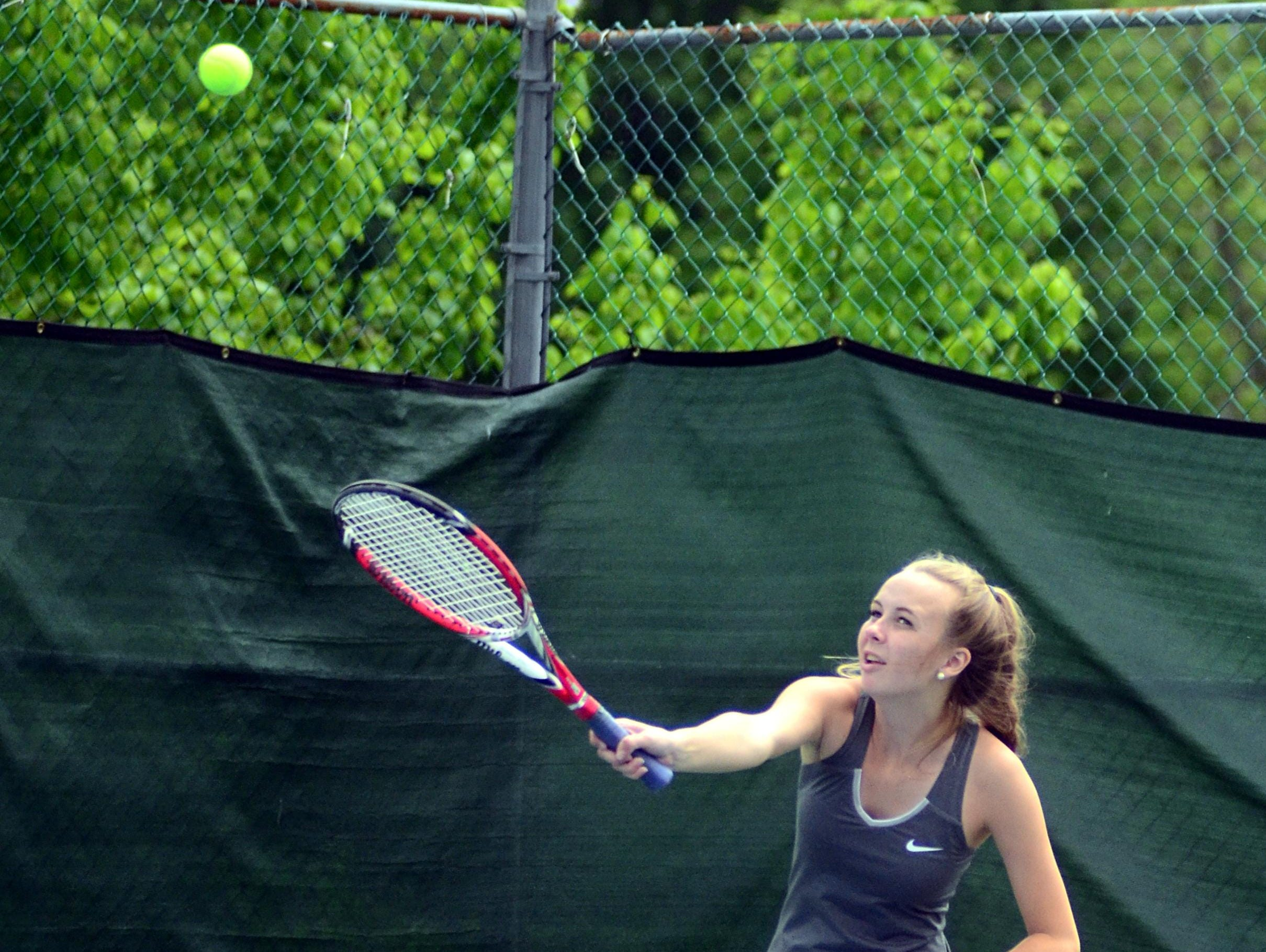 Hendersonville High senior Allison Newell serves during Tuesday's District 9-AAA Individual Tennis Tournament. Newell and classmate Rae Gullett won their semifinal match and advanced to the Region 5-AAA Tournament.