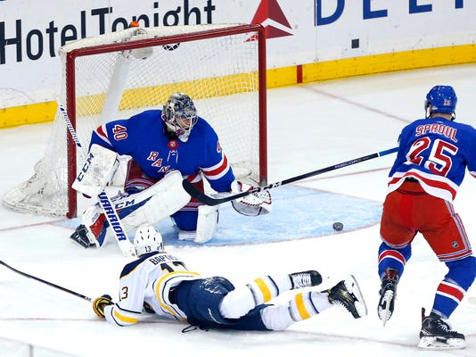 New York Rangers goaltender Alexandar Georgiev (40) and defenseman Ryan Sproul (25) defend a shot by Buffalo Sabres right wing Nicholas Baptiste (13) during third period of an NHL hockey game, Saturday, March 24, 2018, in New York. (AP Photo/Noah K. Murray)