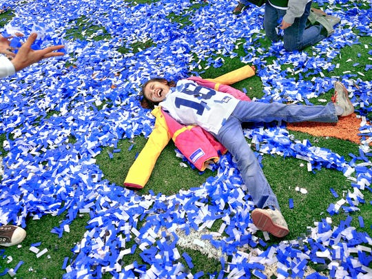 Robin Murphy, niece of Colts linebacker coach Mike Murphy, makes angels in the confetti on the field after the 30-17 AFC Championship win over the Jets at Lucas Oil Stadium, January 24, 2010.