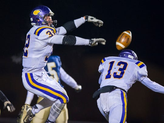 Guerin Catholic High School senior Evan Hansen (32) blocked the extra-point attempt of Tri-West during the IHSAA Class 3A Regional Championship on Nov. 14, 2014.