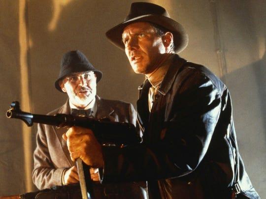 "Sean Connery as Professor Henry Jones and Harrison Ford as Indiana Jones in ""Indiana Jones and the Last Crusade"" (1989)."