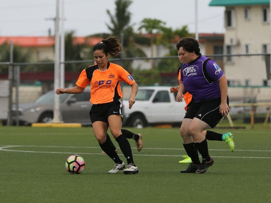 Personal Finance Center Lady Crushers' Anjelica Perez attempts to turn to the goal facing defensive pressure from Hyundai's Tiana Piper during a Week 2 match of the Bud Light Women's Soccer League at the Guam Football Association National Training Center played Sept. 24.