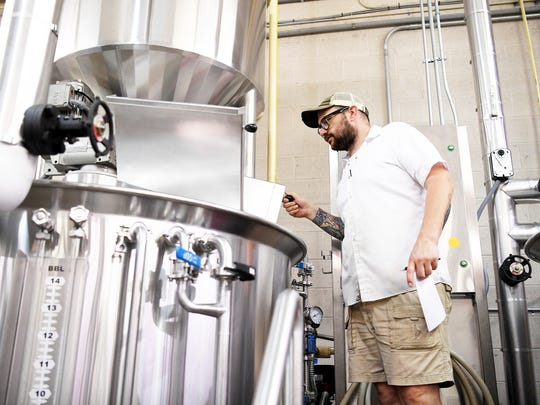 Chad Gibson looks into Sweeten Creek Brewing's new mash tun July 19, 2017. The brewery will increase capacity tenfold this year.