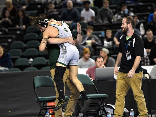 Ricky Cabanillas of DePaul jumps onto his coach after