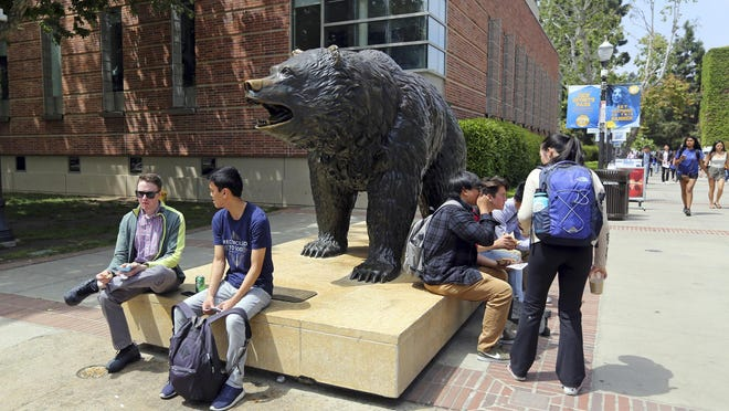 People move about the campus of the University of California, Los Angeles Friday, April 26, 2019.