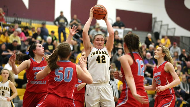 Seaside defenders surround Cascade's Halle Wright in the first half of the OSAA Class 4A state quarterfinals on Thursday, March 9, 2017, at Forest Grove High School.