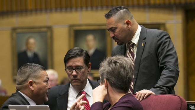 Sen. Lupe Contreras D-Avondale, (from left) Sen. Steve Farley, D-Tucson, Sen. Katie Hobbs D-Phoenix and Sen. Martin Quezada, D-Phoenix, converse as the Senate votes on the floor in the Senate during the sixth day of the Arizona teacher walkout at the Arizona state capitol in Phoenix on Thursday, May 3, 2018.  Today will likely bill the final day of the walkout as Governor Ducey signed an education funding bill into law early Thursday morning.