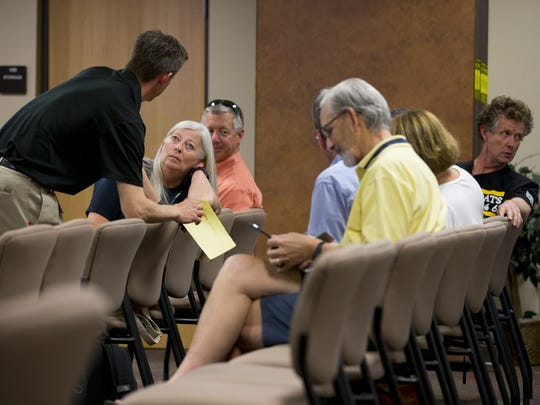 Scottsdale residents wait to see if the school board gives severance packages for Superintendent Denise Birdwell and chief Operating Officer Louis Hartwell during a special Scottsdale school board meeting on April 6, 2018.