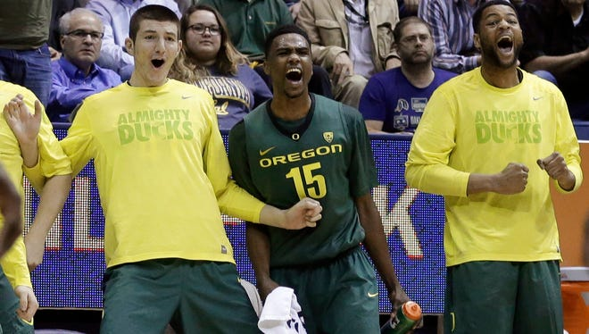 Oregon's Jalil Abdul-Bassit (15) reacts with teammates on the bench during the second half of an NCAA college basketball game against California on Wednesday, Feb. 25, 2015, in Berkeley, Calif. Oregon won 80-69.