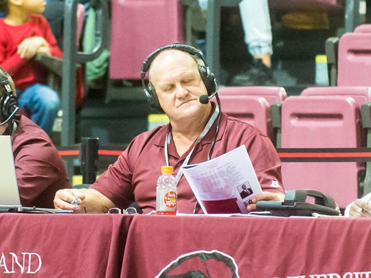 UMES radio announcer David Byrd checks his notes during